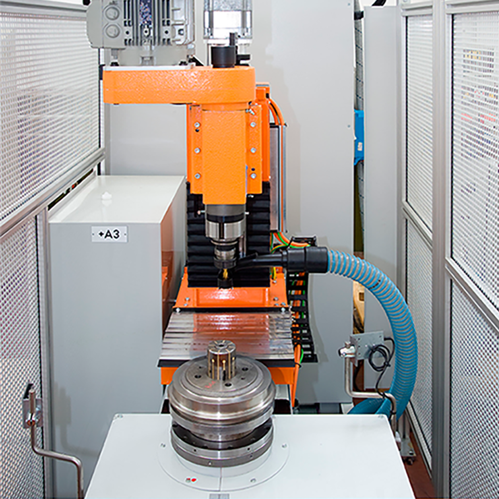 Balancing machine with automatic drilling unit